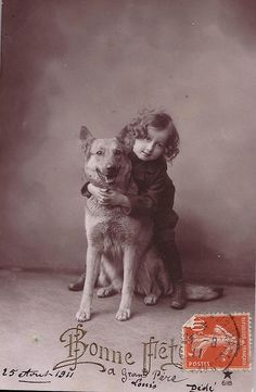 Vintage postcard of little girl and dog