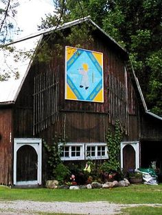 Love the barn ~ quilt okay...