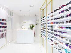 """We can find KRION in Multiopticas Sunglasses transformed into a reception desk with the backlit """"mó"""" logo, shelving, and the display ... Solid Surface"""