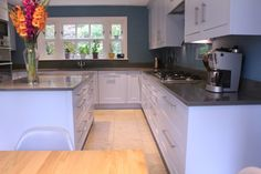 Quartzforms QF Dark Grey worktops and upstands on matt shaker kitchen.