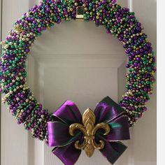 **TRY** Mardi Gras themed wreath. Love the colourful beads!