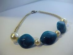 bracelet: faux pearls and blue beads on white chain.