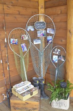 Rustic wedding at fishing lodge.  Display of fishing pictures from both sides of family on fishing nets.  Great catch!