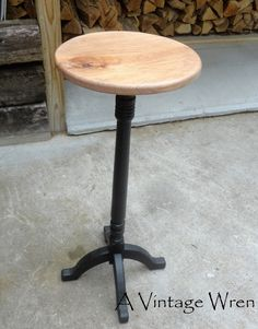 Pedestal table designed and made by our then 13 year old son, he repurposed an antique stair baluster as the column, designed and cut the feet and the top. https://www.facebook.com/AVintageWren