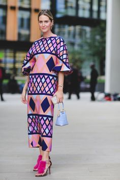 Yes you can wear a bold print, a statement shoe, and a baby bag all at the same time. #refinery29 http://www.refinery29.com/2015/09/94443/london-fashion-week-spring-2016-street-style-pictures#slide-15