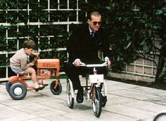 In one clip of the never before seen royal footage, the Duke of Edinburgh The Duke of Edinburgh displays his playful - and competitive - side in a pedalling race with his tractor-riding eldest son, later Prince Charles(Royal Collection Trust)