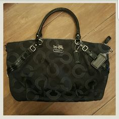 Black/Silver Coach Bag with dust bag Excellent Condition!!!  Kept in dust bag and only carried a handfull of times Durable fabric with C's all over bag in pewter/grey color Authentic Coach Comes with dust bag Coach Bags Satchels