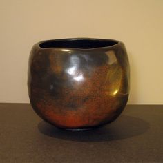 Chawan by T. Terra sigillata sprayed with oil before reduction.