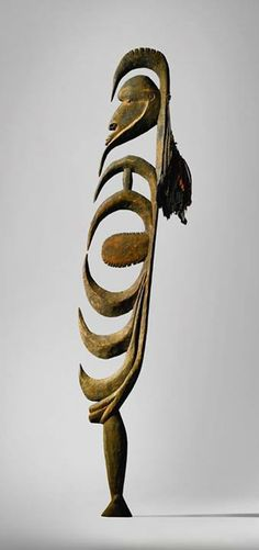 A classical piece from Papua New Guinea. Yimam Hook Figure (Yipwon), Korewari River Region, Papua New Guinea with attachment of Pesquet's Parrot (Psittrichas fulgidus), Sulphur-crested Cockatoo (Cacatua galerita), and Papuan Frogmouth (Podargus papuensis) feathers.