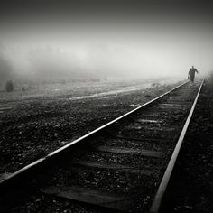 A young man walking home after working on the railroad late. Bw Photography, Monochrome Photography, Black And White Photography, Roof Trusses, Vanishing Point, Arizona Usa, Chiaroscuro, Train Tracks, West Virginia