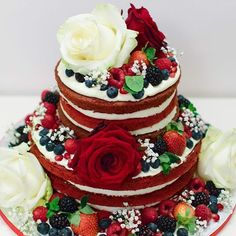 red velvet naked cake topped with roses and berries
