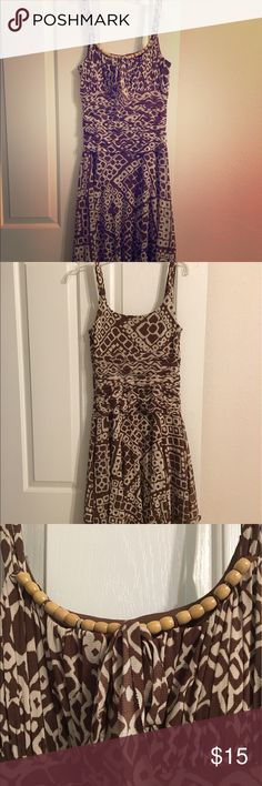 Sundress Light weight spaghetti strap sundress. Zips up the side beaded  neckline with bow and brown liner underneath. Has some loose string on strap. sangria Dresses Midi