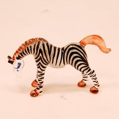 Glass Animal Figurine: handmade African Zebra statuette.  Lampworked in boro glass by hand.. $12.00, via Etsy.