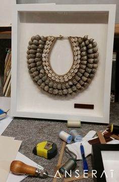 Our gorgeous Papuan shell necklaces being framed // so excited to see the finished products! // check them out at www.anserai.com