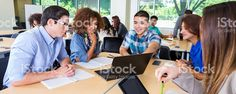 College study group brainstorming together in classroom or library royalty-free stock photo