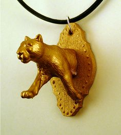 "Hilarious ""taxidermy"" pendants made from plastic toy animals."