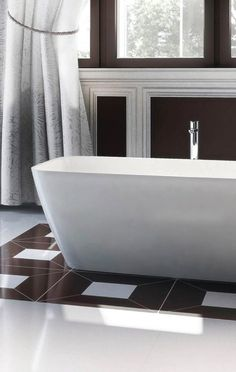 Add a stunning centrepiece in your bathroom with a natural stone bath.