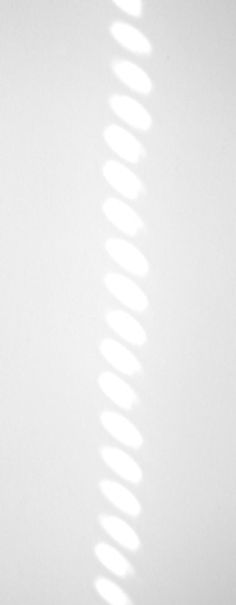 Light falling on a white wall.