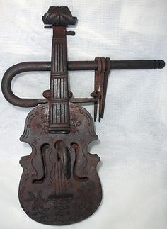 Padlock, a giant Colonial Mexican Style Violin shaped padlock.