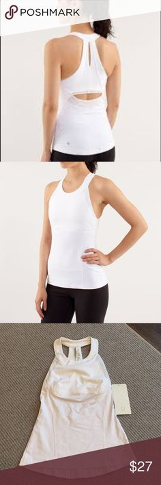 Lululemon white make it count tank size 4 New with tags Lululemon make it count tank size 4. Selling because it's too small for me, in perfect unworn condition.  Light support shelf bra attached to tank. Tight fitting tank. lululemon athletica Tops Tank Tops