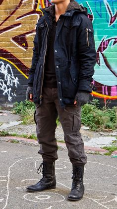 veroz is wearing: Navy Fishtail Parka by Spiewak, Black Polo by All Saints, Charcoal Cargo Pants by Ralph Lauren, Black Sidezip Combat Boots by All Saints.