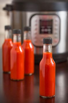 Make homemade hot sauce in your pressure cooker! This Instant Pot Hot Sauce recipe is easy, fast, and tasty with Fresno chilis, garlic, and a smoky note.