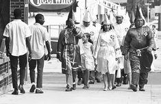Two young black men pass Ku Klux Klan marchers in downtown Salisbury August 1964 Rare Historical Photos, Rare Photos, Vintage Photos, Einstein, Ku Klux Klan, African Diaspora, Awkward Moments, African American History, History Facts