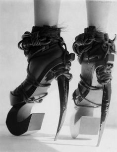 """Aoi Kotsuhiroi's Orchidacea Hermaphroditus Known for her conceptual """"body objects,"""" the French-based artist explored the beauty of the grotesque with this provocatively named piece from her """"Exotic Regrets"""" collection. The menacing heel asserts power as the foot concedes to the waxed linen rope, tying it down in the style of kinbaku, a Japanese form of bondage characterized by intricate knots and aesthetic rules for restraint."""