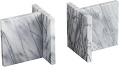rock steady. Crafted to mimic the shape of raw industrial I-beams, these pure marble supports edge a bit more elegant. Style them on shelves and tabletops—with or without books.