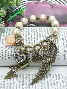 Retro copper heart pink flower wing arrow pearl beads bracelet vintage style. $5.99, via Etsy.