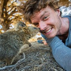 """Allan Dixonis a self-proclaimed """"animal whisperer,"""" and if his incredible selfies are any indication, the title is one that's well-earned. He's posted many pictures on his wanderlust-inducing Instagram that show him posing with various creatures, both large and small. Some are more photogenic than others, but adorable animals like kangaroos, goats, ponies and quokkas are always accompanied next to a grinning Dixon. The Australian adventurer seems to have an lovable rapport with these furry…"""