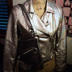 NWOTS/MOTTO JACKET/FOREVER 21/ NEVER WORN NWOTS/FOREVER 21 MOTTO JACKET/this jacket is pewter in color with a Crossbody zipper accent across the front of the jacket. The jacket has 21 1/2 inch long sleeves, the body of the jacket is 16 1/2 inches long, There are epaulet accents at the shoulders and zippers on the pockets. It looks great with the B MAKOWSKY GLOVE LEATHER CROSSBODY also listed in my closet!!! THIS IS A NEW WITHOUT TAGS NEVER WORN FOREVER 21 MOTO JACKET!!! Forever 21 Jackets…