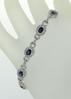 Next up in our Mother's Day gift suggestion list, Fine Blue Ceylon Sapphire and Diamond 18 karat White gold bracelet, claw set with 10 oval shaped Sapphires weighing a total of 4.45 carats, surrounded by 399 micro-claw set round brilliant cut Diamonds weighing a total of 1.55 carats.