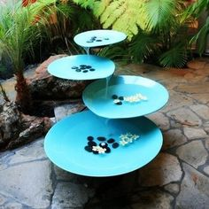 Falling Water Fountain - The Lily Pad fountain infuses a magical ambiance in any outdoor setting. The tranquil sound of flowing water relaxes and calms the senses. This mid century sculptural piece resembles a lily pad; is custom made of double powder coated metal, with a four tier fountain, allowing for a constant flow of water.