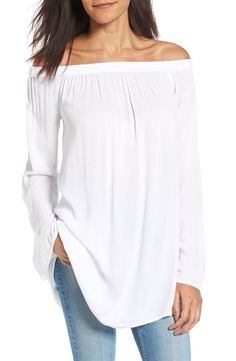 A half-moon cutout at the back offers a playful flash of skin in this shoulder-baring top with a breezy, longline silhouette that's oh-so-romantic.