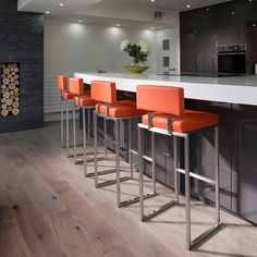 Set Of 4 Luxury Orange Kitchen Breakfast Bar Stool/Stool/Barstool 912O. Ultra Stylish Modern High Quality Barstool from the Quatropi Design Studio. Commercial standard heavy duty faux leather stool with brushed stainless steel stem and base. Call 02476 642139 or email sales@quatropi.com or visit www.quatropi.com for additional information.