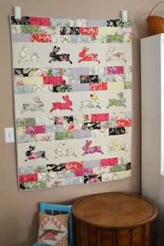 "Bunny Bricks Quilt Tutorial...A new bunny wall quilt is long over due! When I came across this amazing line of fabric from Anna Griffin, called Grace,.... I paired the rectangle ""bricks"" with a bunny silhouete appliqué from Sizzix. I'm in love!"