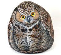 Hand painted rocks. Wildlife animals painted on stone by Italian artist Ernestine Gellina