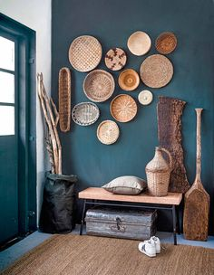 This paint color is similar to Hirshfield's 0669 Frozen Stream. The wall color highlights the warmth of the wooden pieces and baskets.