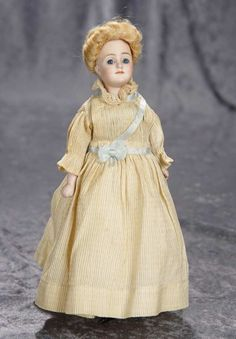 "10"" German bisque ""Gibson Girl"" by Kestner in rare smallest size, model 172~~~blonde mohair wig in up-swept fashion, muslin stitch-jointed body, bisque lower limbs, painted ribbed stockings and three strap heeled shoes, nicely costumed. Marks: 6/0 172. Kestner, circa 1912, the model was based on the illustrations of the American artist, Charles Dana Gibson, and this is the smallest of the three sizes made."