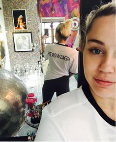 Miley Cyrus professes love for Liam Hemsworth by rocking t-shirt with his name