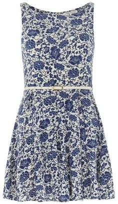blue and white china print dress with flared skirt and fitted waist