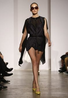 A model walks down the runway during Isabel Toledo's spring and summer collection show, Wednesday, Oct. 19, 2011, in Miami.  (AP Photo/Lynne Sladky)