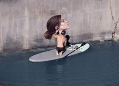 Balancing Act: Sean Yoro paints Seaside Murals from a surfboard