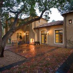 Brick patio designed around a tree