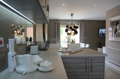 An open-plan kitchen and dining room with breakfast bar and snug area at the Emerald. #Strata