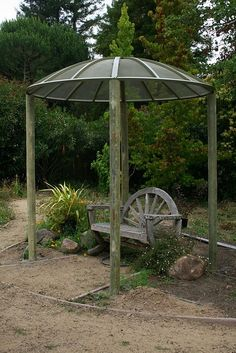 This satellite dish gazebo is held up with fence posts. What a great way to recycle an item no longer in use.