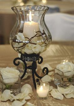 Wedding, Reception, Centerpiece, Silver - Photo by Christine Gomez - Project Wedding Check out the website for more. Wedding Reception Centerpieces, Candle Centerpieces, Candle Lanterns, Wedding Decorations, Hurricane Centerpiece, Silver Centerpiece, Wedding Ideas, Chandeliers, Candle In The Wind