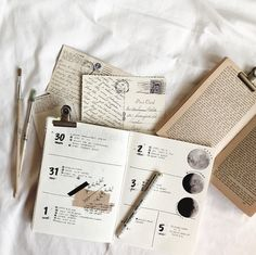 patience. — Vintage postcards, paintbrushes, and books giving...