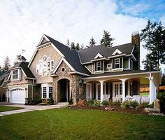 charcoal roof, tan siding, natural stone, white trim, dark shutters, light window panes